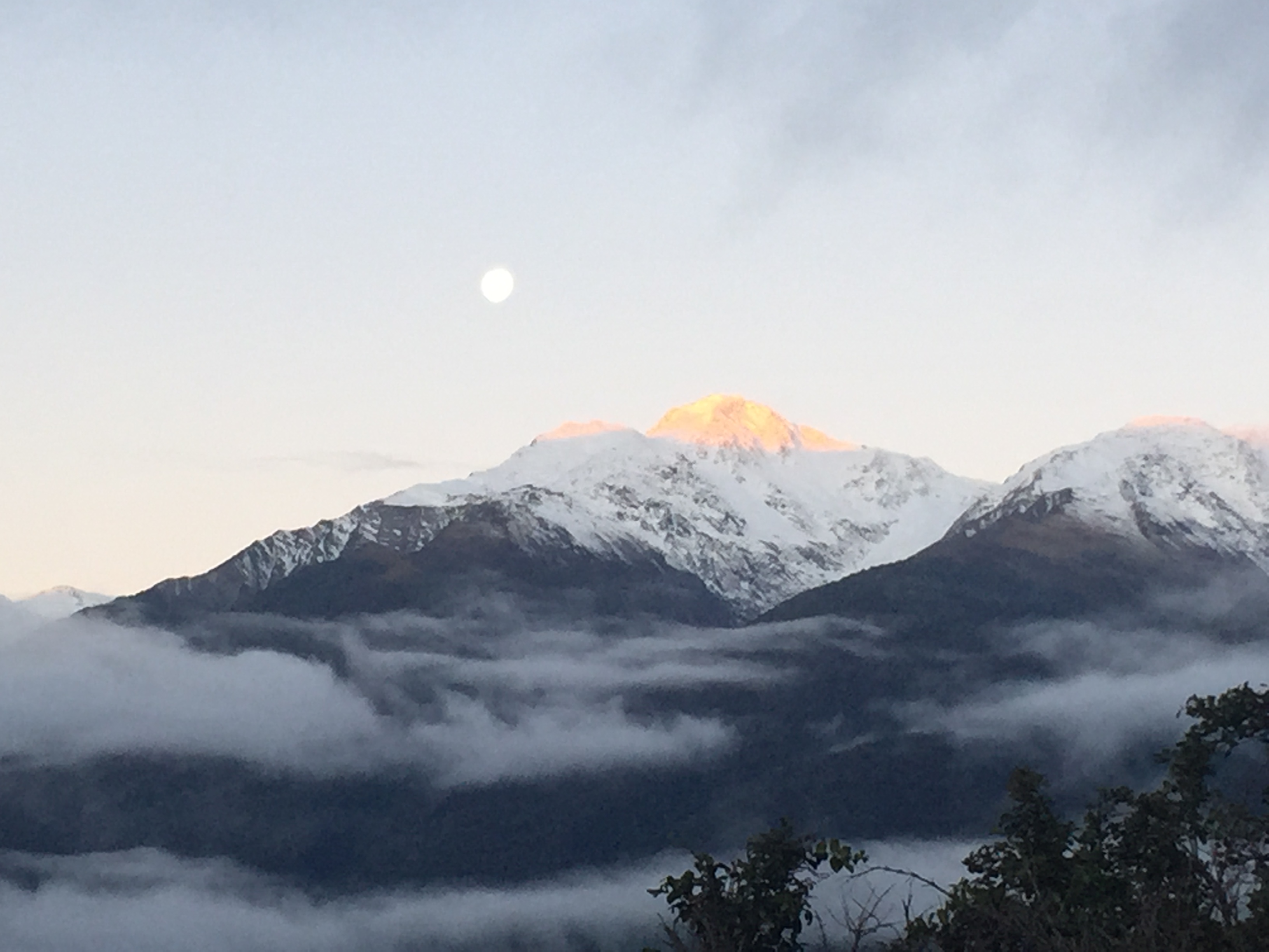 The moon over Haast Pass mountains